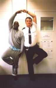 Two yoga practitioners in a Prison Phoenix Trust class at HMP Bullingdon, Oxford Courtesy: PPT Archi