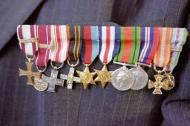 War medals pinned to the chest of a World War I veteran. Photograph: Piotr Malecki/Panos