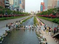 After: residents relaxing on the banks of the Cheonggyecheon river after urban rehabilitation Photog