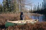Pinip, an Innu hunter, with his canoe. Photograph: Bryan & Cherry Alexander Photography