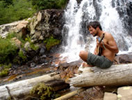 Jeff  Strumming by the waterfall. Photograph: courtesy Jeff Kagan