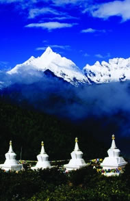 Buddhist stupas in front of Meili Xueshan mountain range including Mt Miacimu (6054m) from Naka Zhashi. Photograph: Richard I'Anson/Lonely Planet Images