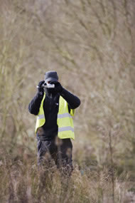 A police officer records a protest against illegal plans to clear vegetation at Radley Lakes Photograph: Adrian Arbib