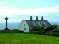 A holiday farmhouse on Bardsey stands next to the cemetery belonging to the old monastery, where some 20,000 saints are said to be buried. Photograph: Courtesy Gail Simmons