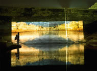A lone sadhu watches the Video art from the live show of The Holiwater Project at the Nahagar Fort Kund, Jaipur, India 2007. Photograph: Andrei Jewell/Holiwater