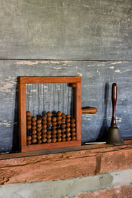 Chalkboard with abacus bell in a one room schoolhouse, courtesy: istock