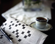 Crossword and coffee © anaimd/istockphoto.com