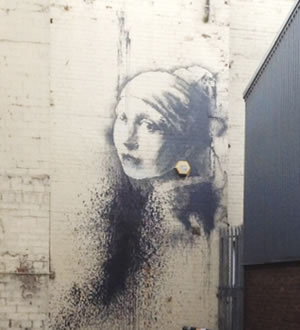 The Girl with the Pierced Eardrum by Banksy