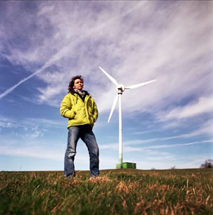 Dale Vince stands in front of the wind turbine at Lynch Knoll